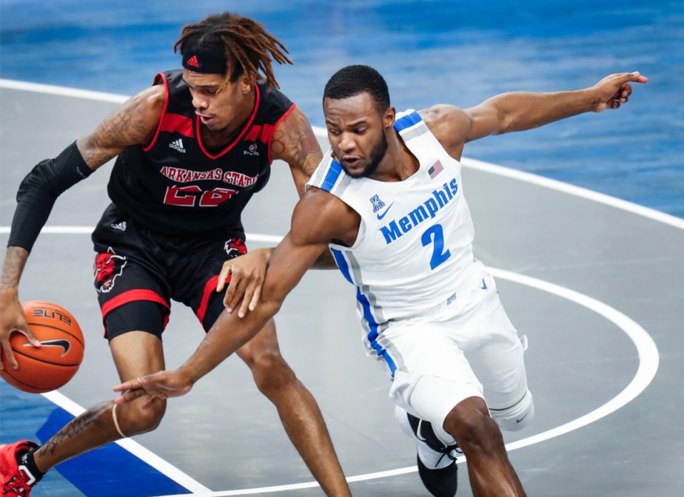 <strong>Alex Lomax (right) goes for a steal against Arkansas State forward Keyon Wesley (left).</strong> (Mark Weber/The Daily Memphian)