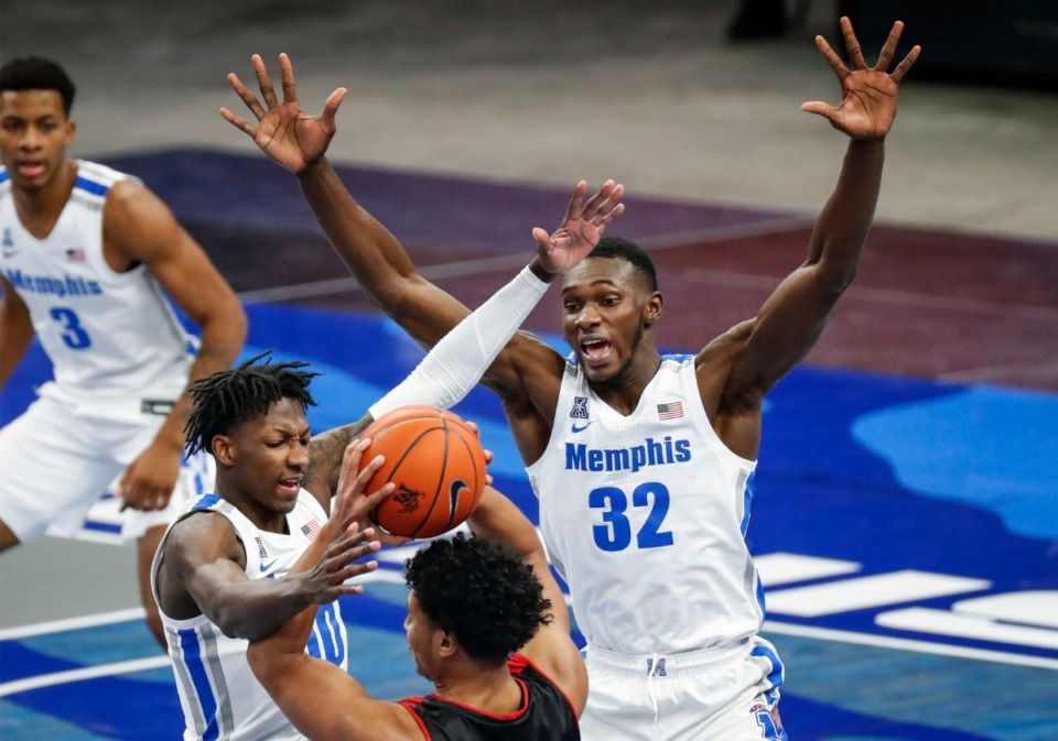 <strong>Tigers Damion Baugh (left) and Moussa Cisse (right) apply pressure to Arkansas State guard Marquis Eato on Dec. 2, 2020. Will Baugh and Cisse be on the floor together a lot? Hard to say.</strong> (Mark Weber/The Daily Memphian)