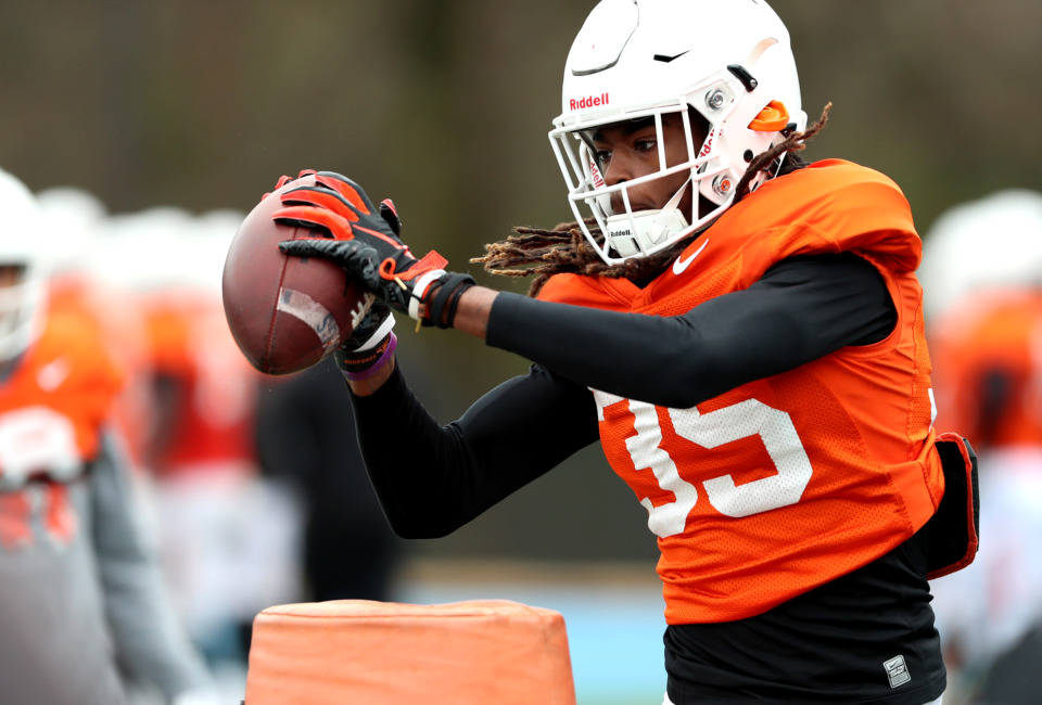 <strong>Oklahoma State Cowboys safety Chance Cook catches a pass during practice at Memphis University School on Wednesday, Dec. 26, 2018. The Cowboys will take on the University of Missouri in this year's Liberty Bowl on New Year's Eve.</strong> (Houston Cofield/Daily Memphian)