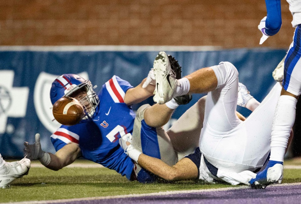 <strong>Christopher Goodwin (7) of MUS reaches for the ball on an apparent fumble during the game against McCallie on Thursday, Dec. 3, 2020, in Cookeville, Tennessee.</strong> (Wade Payne/www.wadepaynephoto.com)