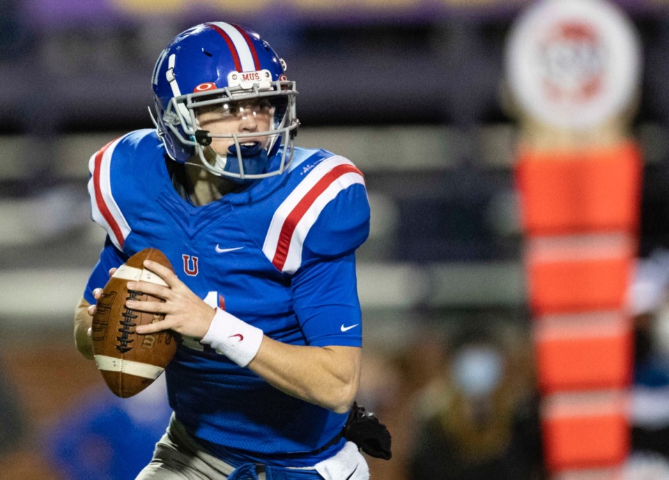 <strong>MUS quarterback Edwin Shy rolls out to pass during the game against McCallie on Thursday, Dec. 3, 2020, in Cookeville, Tennessee.</strong> (Wade Payne/www.wadepaynephoto.com)
