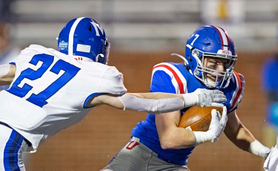 <strong>MUS running back Christopher Goodwin runs for yardage &nbsp;as McCallie&rsquo;s Nic Robinson attempts a tackle.</strong> (Wade Payne/www.wadepaynephoto.com)