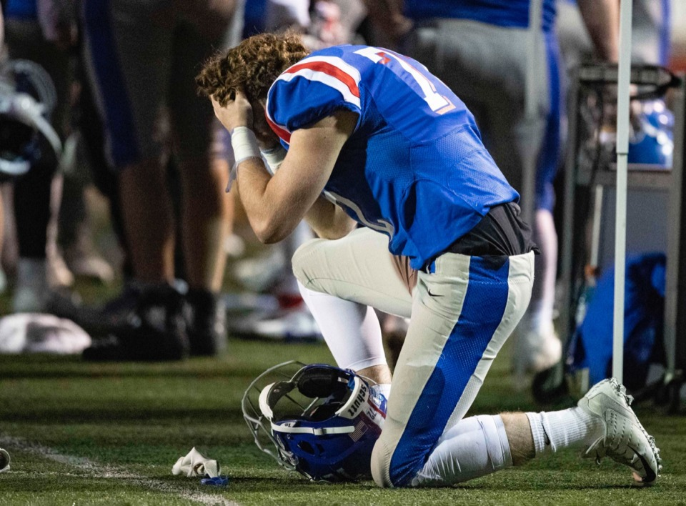 <strong>A dejected Nicholas Galler kneels on the sideline after MUS&rsquo; loss to McCallie.</strong> (Wade Payne/www.wadepaynephoto.com)