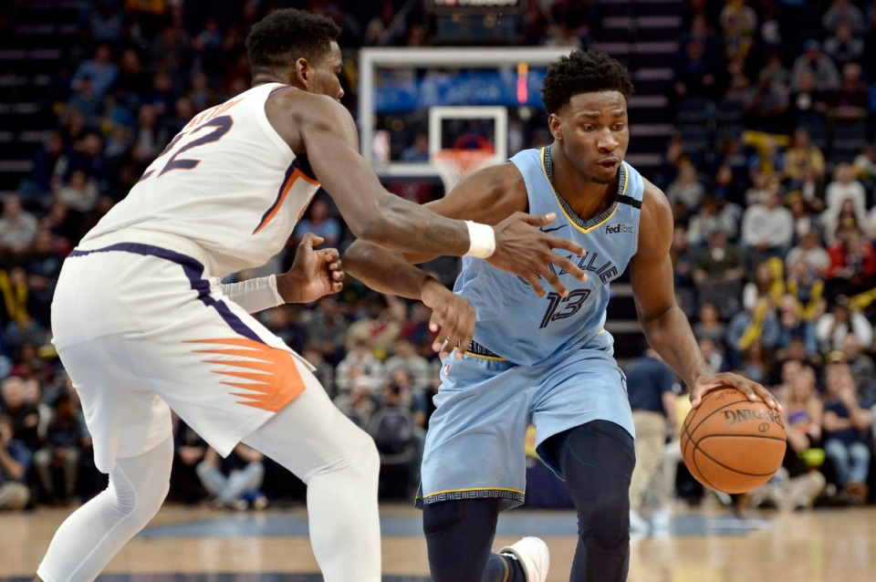 <strong>Memphis Grizzlies forward Jaren Jackson Jr. (13) drives against Phoenix Suns center Deandre Ayton (22) in an NBA basketball game Sunday, Jan. 26, 2020, at FedExForum.</strong> (Brandon Dill/AP file)