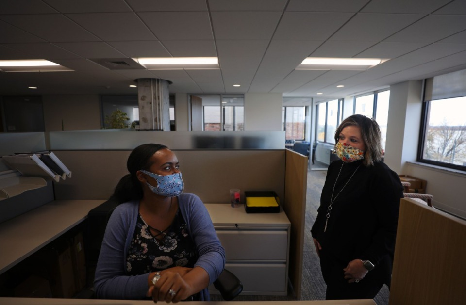 <strong>Erica Jackson (right) and Denise Glasco chat at ALCO Management's Downtown Memphis office Nov. 25, 2020.</strong> (Patrick Lantrip/Daily Memphian)