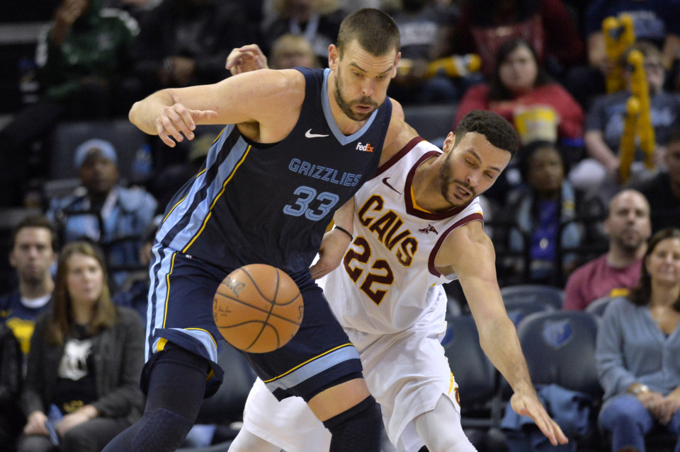 <span><strong>Memphis Grizzlies center Marc Gasol (33) and Cleveland Cavaliers forward Larry Nance Jr. (22) struggle for control of the ball Wednesday, Dec. 26, at FedExForum. Gasol scored 20 points as the Grizzlies bested the Cavs 95-87.</strong>&nbsp;(AP Photo/Brandon Dill)</span>