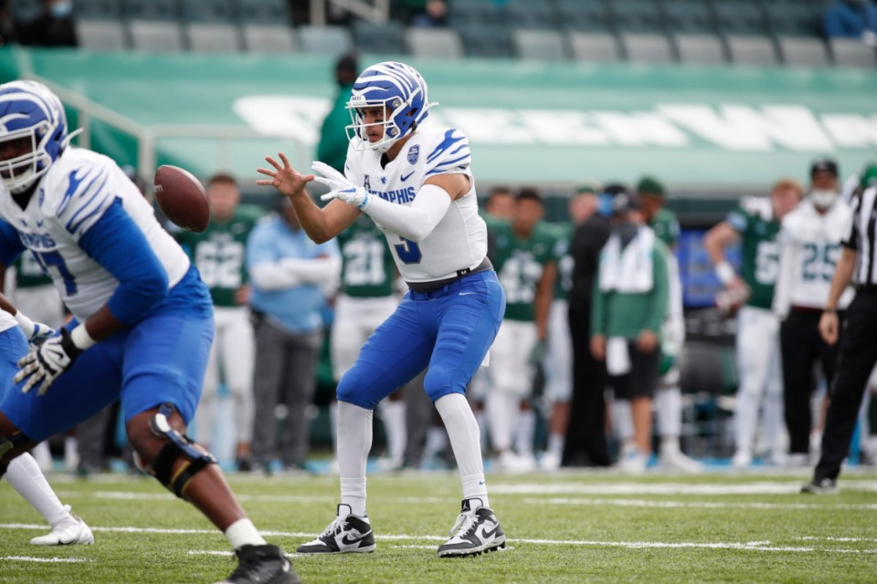 <strong>Quarterback Brady White receives the ball as the Tigers play Tulane&rsquo;s Green Wave, Saturday, Dec. 5, 2020, in New Orleans.</strong> (Tyler Kaufman/Memphis Athletics)