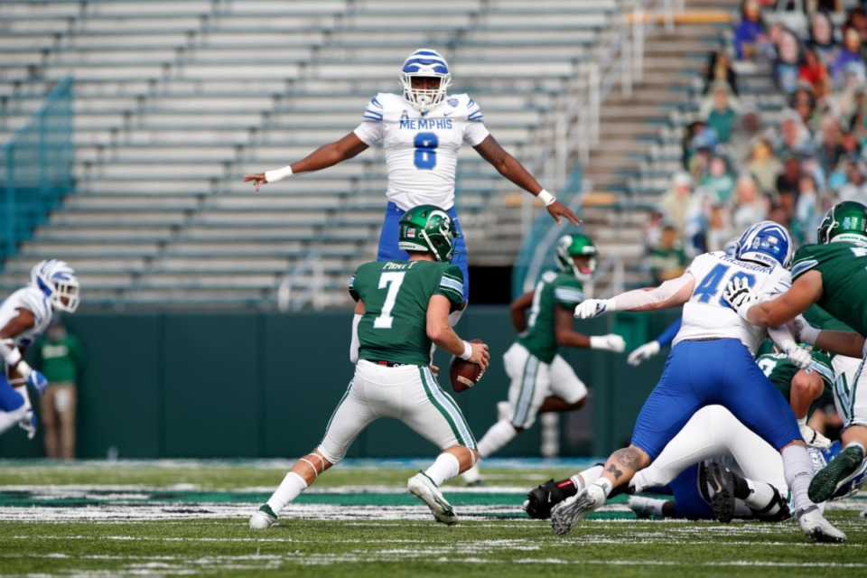<strong>Tigers linebacker Xavier Cullen (8) blocks the path of Tulane quarterback Michael Pratt during the game Saturday, Dec. 5 in New Orleans. Despite losing to Tulane, the Tigers are likely to play in a bowl game.&nbsp;</strong>(Tyler Kaufman/Memphis Athletics)