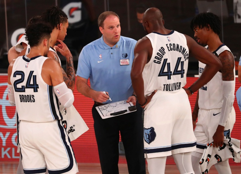 <strong>Memphis Grizzlies head coach Taylor Jenkins (speaking to players during a timeout against the Oklahoma City Thunder Aug. 7, 2020, in Lake Buena Vista, Fla.) said he was&nbsp;&ldquo;fired up&rdquo; about resuming practice.</strong>&nbsp;(Kim Klement/AP)