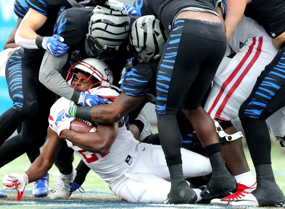 <strong>Memphis Tigers defense stopped Houston Cougars running back Patrick Carr (21) when the two teams met Nov. 23, 2018. The Tigers won 52-31.</strong> (Houston Cofield/Daily Memphian file)