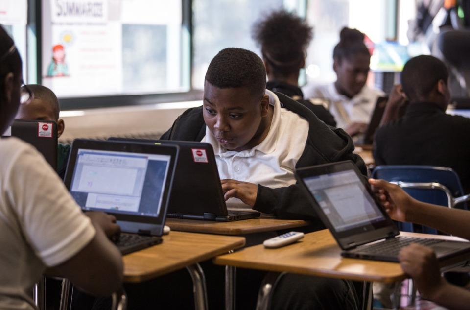 <strong>Sherwood Middle School student Willie White uses a laptop to construct a presentation in teacher Brian Ingram&rsquo;s 7th grade science class</strong>. (Daily Memphian file)