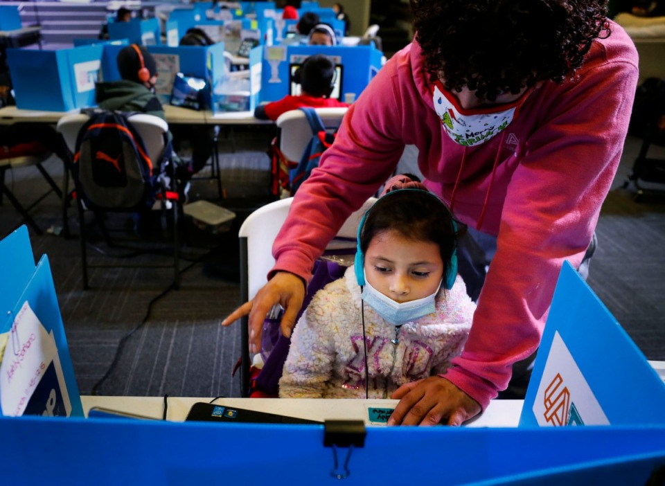 <strong>First grader Ashley Soriano gets help from an education specialist while attending virtual school at Las Americas on Monday, Dec. 7, 2020.</strong> (Mark Weber/The Daily Memphian)