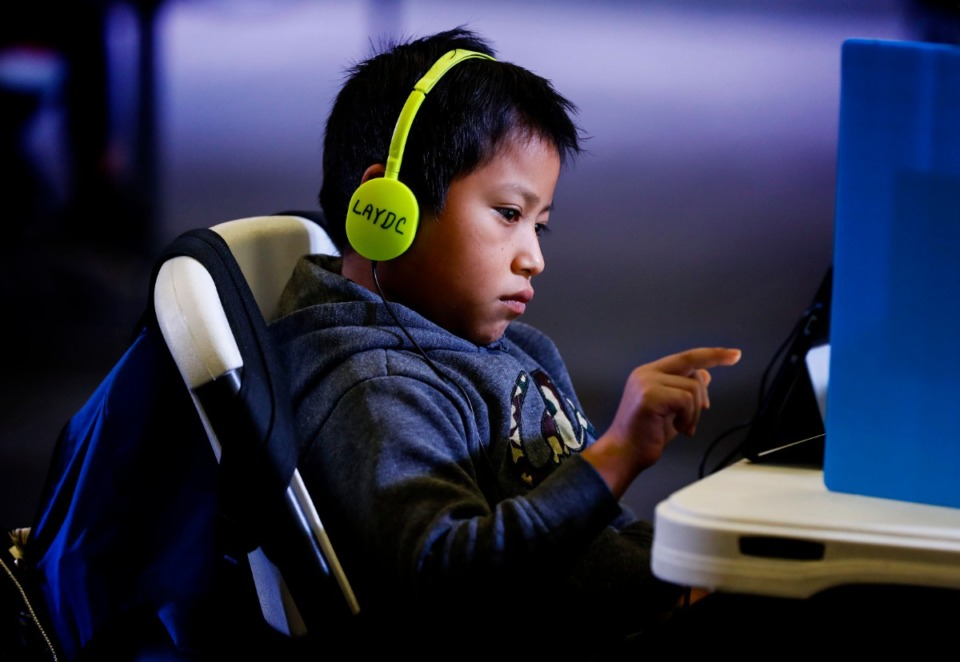 <strong>Second grader Brayan Ramos attends virtual school at Las Americas on Monday, Dec. 7, 2020.</strong> (Mark Weber/The Daily Memphian)