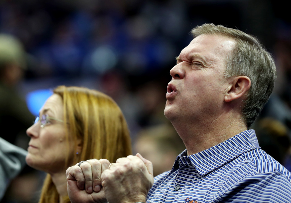 <strong>Former Memphis State basketball player John McLaughlin reacts to a call by the referee during the Tigers' game against the Little Rock Trojans on Dec. 19. McLaughlin, originally from rural Monticello, Indiana, played for the Tigers in the late '80s and early '90s.</strong><span>&nbsp;</span><strong>&ldquo;Memphis was always my second home,&rdquo; he said.</strong><span>&nbsp;(Houston Cofield/Daily Memphian)</span>
