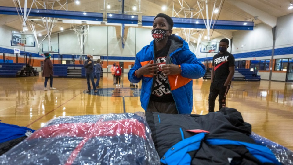 <strong>Jayden Williams tries on and selects a new winter coat as part of the Operation Warm distribution at Memphis Athletic Ministries on Tuesday, Dec. 8.</strong> (Ziggy Mack/Special to the Daily Memphian)