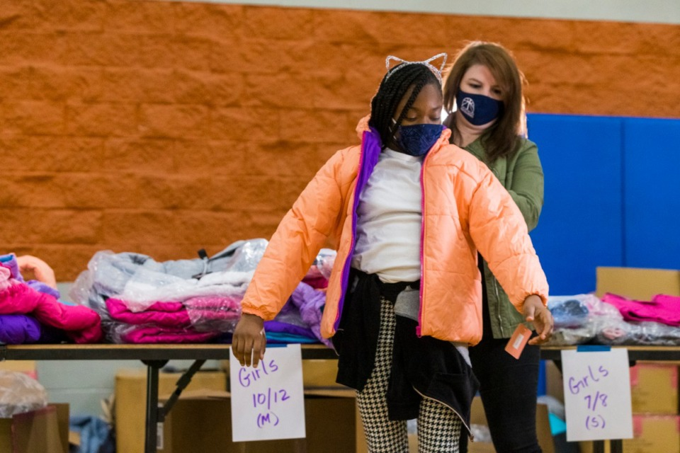 <strong>Ginny Windsor helps Amya Hubbard select a new winter coat during an Operation Warm distribution on Tuesday, Dec. 8.</strong>&nbsp;(Ziggy Mack/Special to the Daily Memphian)