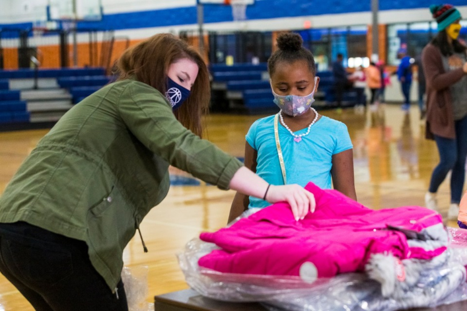<strong>Ginny Windsor helps Delaney Anderson select a new winter coat on Tuesday, Dec. 8.</strong>&nbsp;(Ziggy Mack/Special to the Daily Memphian)