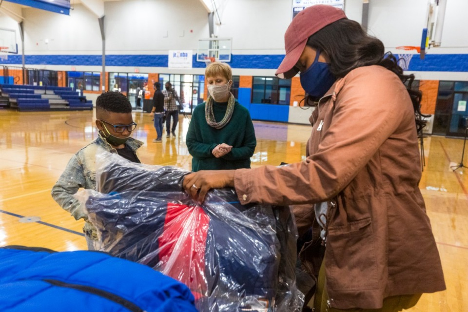 <strong>Mandie Johnson helps Christopher Beecher select a new winter coat at Memphis Athletic Ministries on Tuesday, Dec. 8.</strong>&nbsp;(Ziggy Mack/Special to the Daily Memphian)
