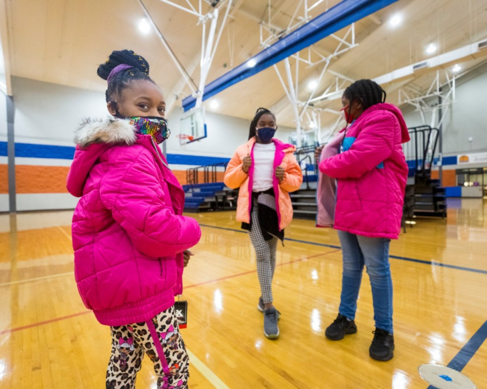 <strong>Makenzie Ousley (from left), Amya Hubbard and Riayna Anderson show each other their new coats on Tuesday, Dec. 8.</strong>&nbsp;(Ziggy Mack/Special to the Daily Memphian)