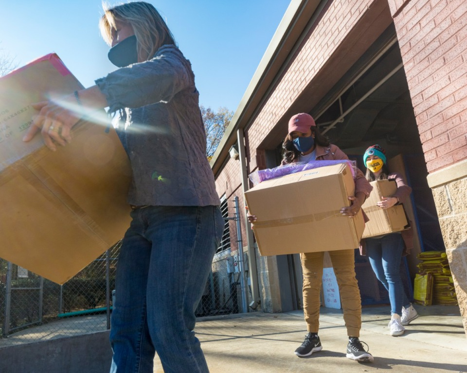 <strong>Kim Cherry (from left), Mandie Johnson and April Eliason load coats to be transported to locations around Memphis on Tuesday, Dec. 8.</strong>&nbsp;(Ziggy Mack/Special to the Daily Memphian)
