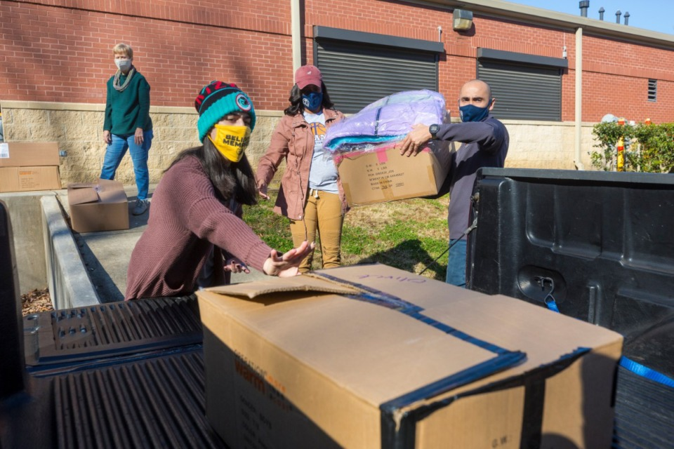 <strong>Anne Chambers (from left), April Eliason, Mandie Johnson and Jonathan Torres transport new winter coats to various locations around Memphis as part of the Operation Warm program on Tuesday, Dec. 8.</strong>&nbsp;(Ziggy Mack/Special to the Daily Memphian)