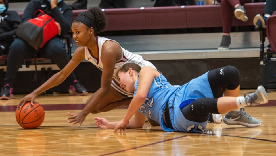 <strong>Collierville guard Mallory Taylor (1) and Northpoint guard Izzy Carlson (22) fight for a loose ball on Tuesday, Dec. 8, 2020, at Collierville High School.</strong> (Greg Campbell/Special to The Daily Memphian)