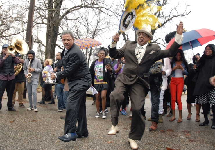 <strong>A second line parade honors local chef Gary Williams on Dec. 15. The band Williams helped create organized the parade that culminated at Krewe of DeJavu, Williams' restaurant at 936 Florida.</strong> (Stan Carroll/Special to The Daily Memphian)