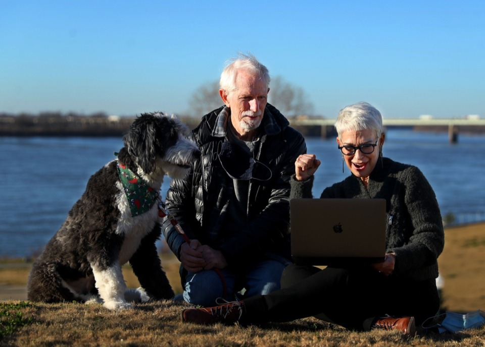 <strong>President and CEO of the Memphis River Parks Partnership Carol Coletta (right) watches the virtual groundbreaking for Tom Lee Park with John Montgomery and their dog Max at Vance Park Dec. 9, 2020.</strong> (Patrick Lantrip/Daily Memphian)
