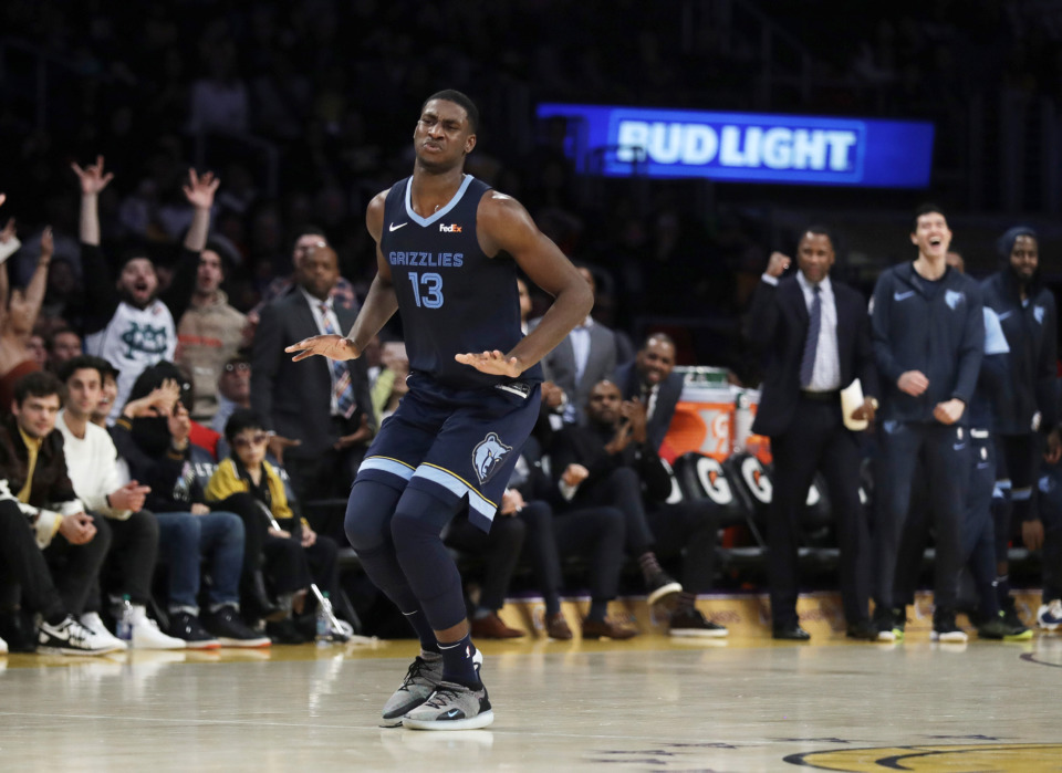 <strong>Memphis Grizzlies' Jaren Jackson Jr. (13) reacts after making a 3-point basket against the Los Angeles Lakers during the second half of an NBA basketball game, Sunday, Dec. 23, 2018, in Los Angeles.</strong> (AP Photo/Marcio Jose Sanchez)
