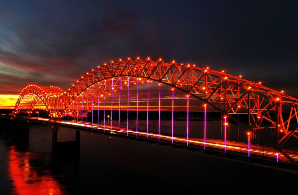 <strong>Cars streak across the red-lit Hernando Desoto Bridge spanning the Mississippi River as seen from Mud Island River Park in Memphis, Tennessee Oct. 31, 2020.</strong> (Patrick Lantrip/Daily Memphian)