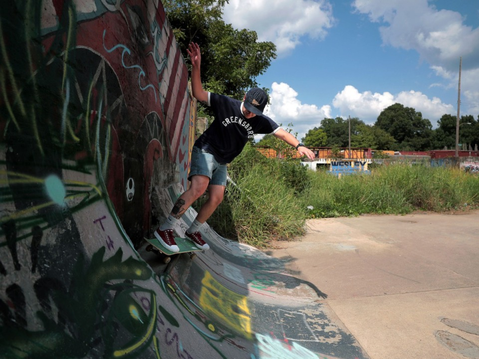 <strong>Eli Berry skates on a ledge at Altown, an empty lot-turned-skatepark hidden just off Lamar Avenue, on Sept. 9.</strong> (Patrick Lantrip/Daily Memphian)
