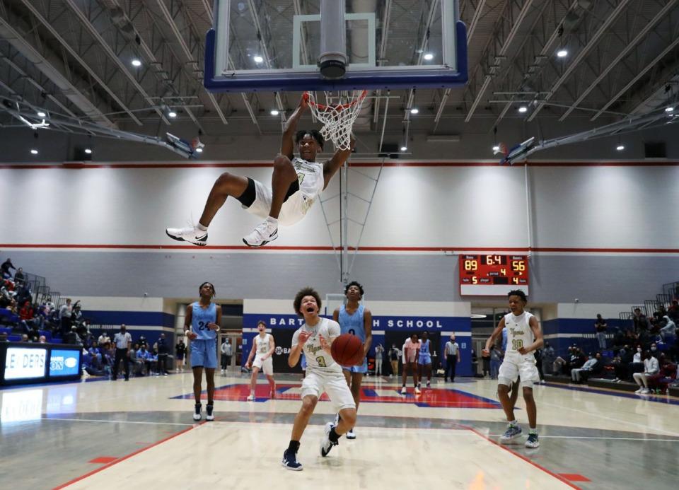 <strong>Arlington High School guard Madison Peaster (4) slams home a buzzer-beating dunk to cap off a win over Calhoun High School on Dec. 11, 2020, at Bartlett High School.</strong> (Patrick Lantrip/Daily Memphian)