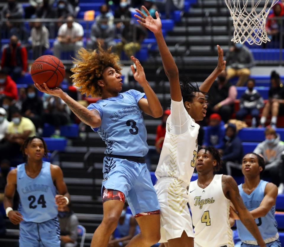 <strong>Calhoun High School guard J.D. Davison (3) goes up for a layup during a Dec. 11, 2020, tournament game against Arlington at Bartlett High School.</strong> (Patrick Lantrip/Daily Memphian)
