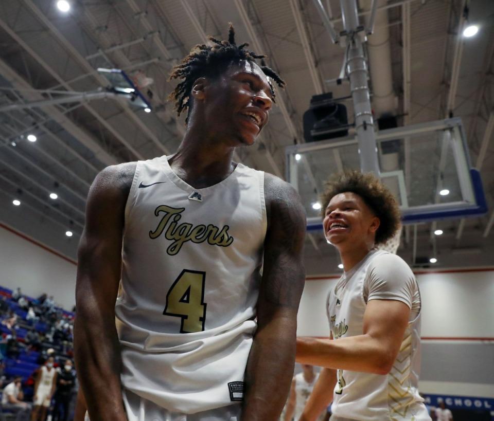 <strong>Arlington High School guard Madison Peaster (4) celebrates with Philip Dotson (3) after a buzzer-beating dunk to cap off a win over Calhoun High School on Dec. 11, 2020.</strong> (Patrick Lantrip/Daily Memphian)