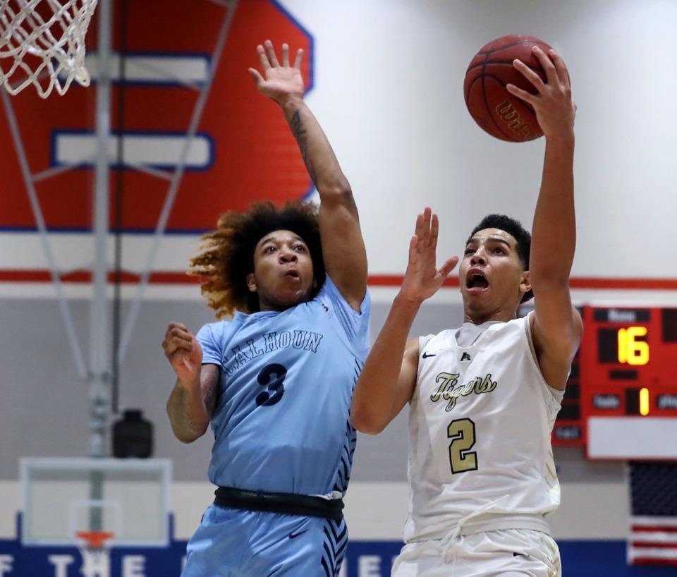 <strong>Arlington High School guard Isaiah Jones (2) goes up for a layup over Calhoun High School guard J.D. Davison (3) on Dec. 11, 2020.</strong> (Patrick Lantrip/Daily Memphian)