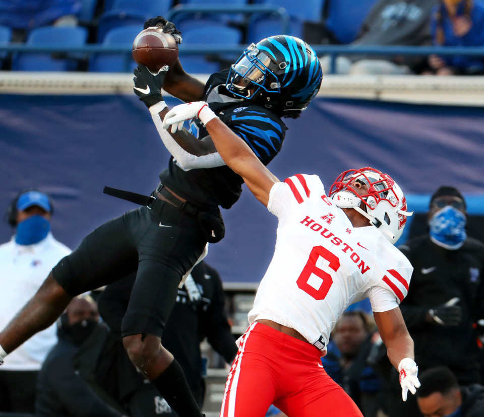 <strong>University of Memphis wide receiver Tahj Washington (18) goes up for a catch during a Dec. 12, 2020 game against the University of Houston.</strong> (Patrick Lantrip/Daily Memphian)