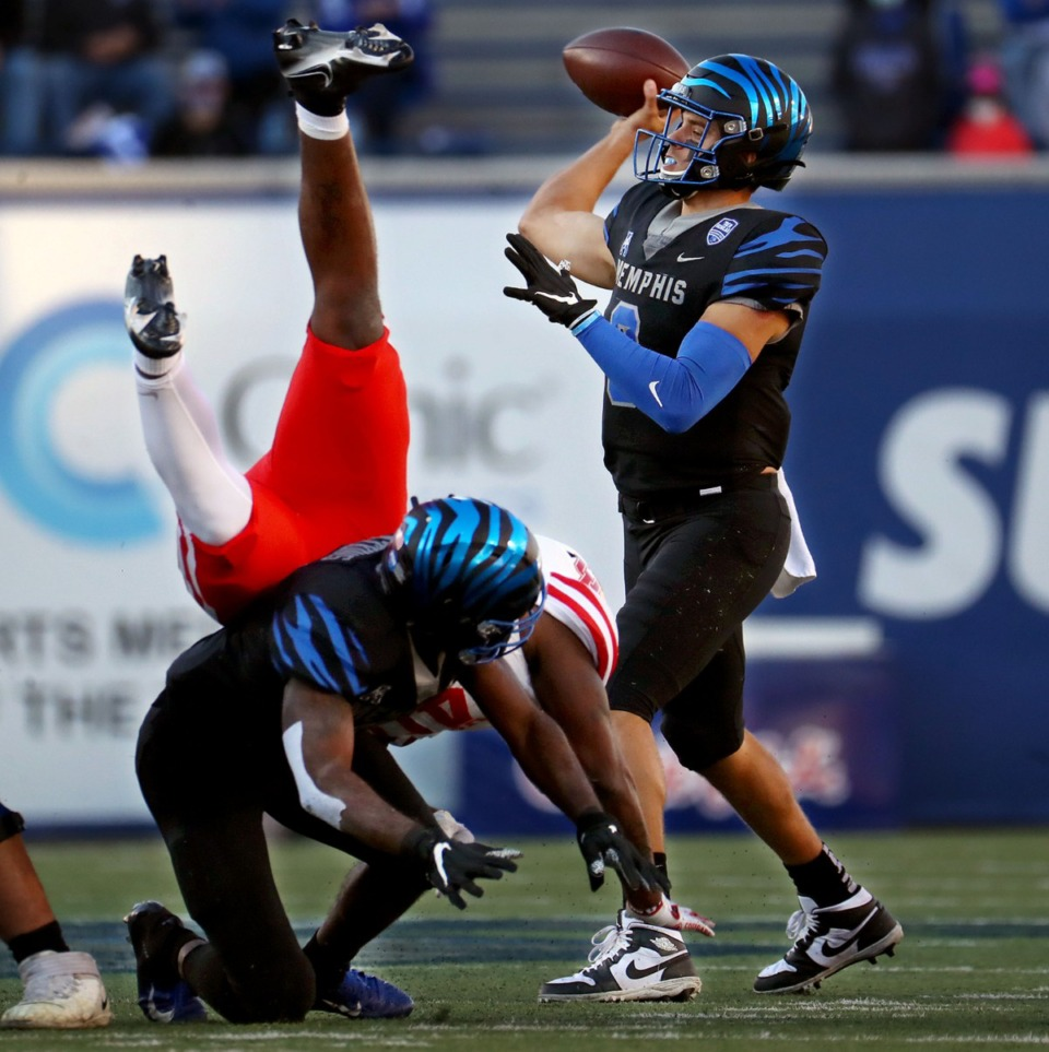 <strong>University of Memphis quarterback Brady White (3) hangs in the pocket to complete a pass during a Dec. 12, 2020 game against the University of Houston.</strong> (Patrick Lantrip/Daily Memphian)