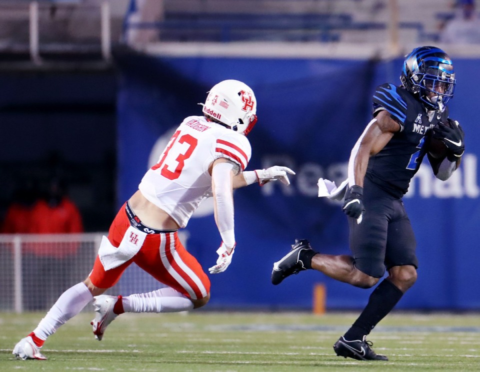 <strong>University of Memphis running back Rodrigues Clark (2) tries to evade a defender during a Dec. 12, 2020 game against the University of Houston.</strong> (Patrick Lantrip/Daily Memphian)