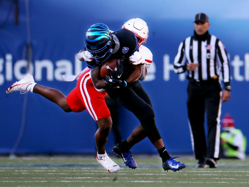 <strong>Univertiy of Memphis wide receiver Kylan Watkins (17) gets brought down during a Dec. 12, 2020 game against the University of Houston.</strong> (Patrick Lantrip/Daily Memphian)