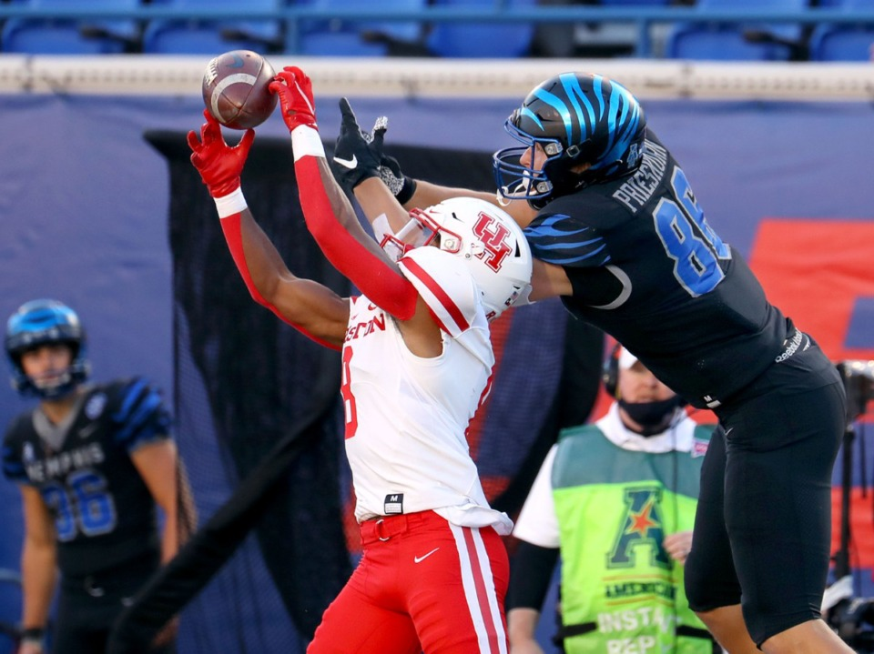 <strong>University of Houston cornerback intercepts the ball over University of Memphis tight end Caden Prieskom (86) during a Dec. 12, 2020 game against the University of Houston.</strong> (Patrick Lantrip/Daily Memphian)