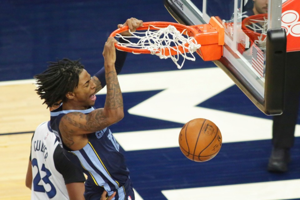 <strong>Memphis Grizzlies guard Ja Morant (12) dunks in front of Minnesota Timberwolves Jarrett Culver (23) in the third quarter during an NBA preseason basketball game, Saturday, Dec. 12, 2020, in Minneapolis.</strong> (Andy Clayton-King/AP)