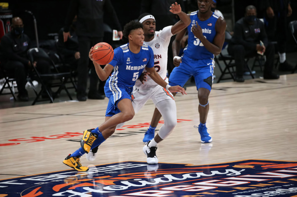 <strong>Memphis Tigers guard Boogie Ellis (5) looks to make a pass during the Holiday Hoopsgiving NCAA basketball game between the Memphis Tigers and the Auburn Tigers on Dec. 12 at State Farm Arena in Atlanta.</strong> (Courtesy Michael Wade)