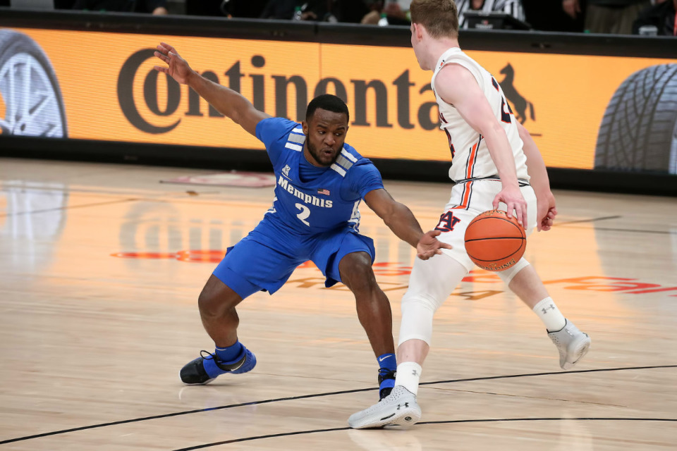 <strong>Memphis Tigers guard Alex Lomax defends against Auburn in the Holiday Hoopsgiving game Saturday, Dec. 12, 2020 at State Farm Arena in Atlanta.</strong> (Courtesy Michael Wade)