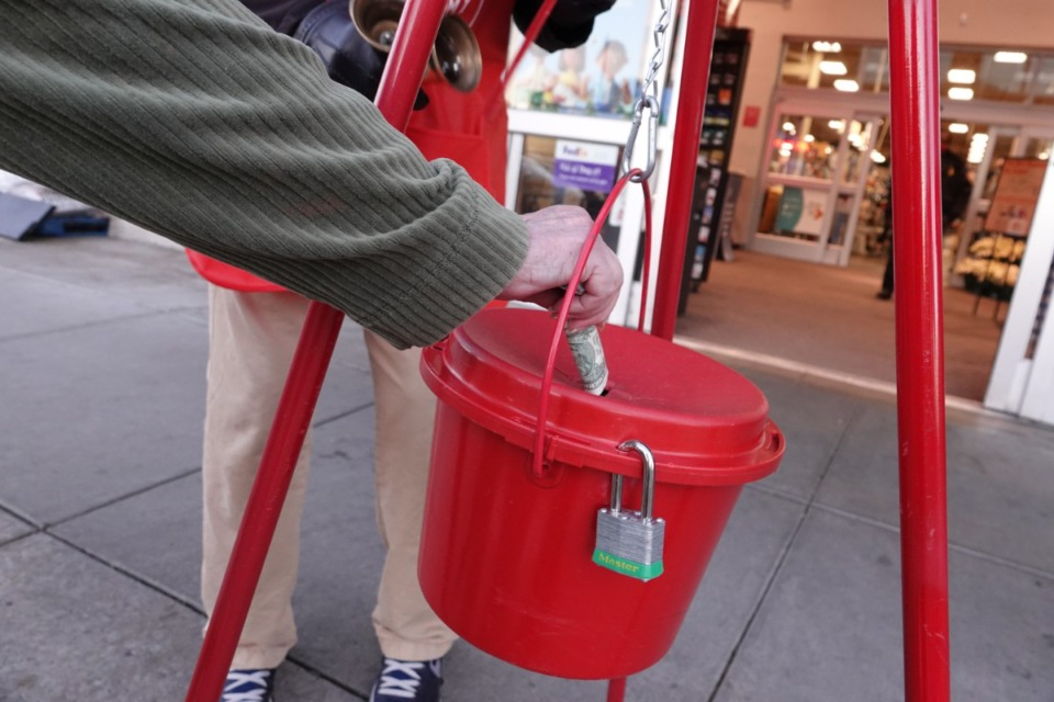 <strong>The Salvation Army red kettle goes back to the 1800's as a tool used to collect money for the poor. This year, due to the pandemic, the contributions are down.</strong> (Karen Pulfer Focht/Special To The Daily Memphian)