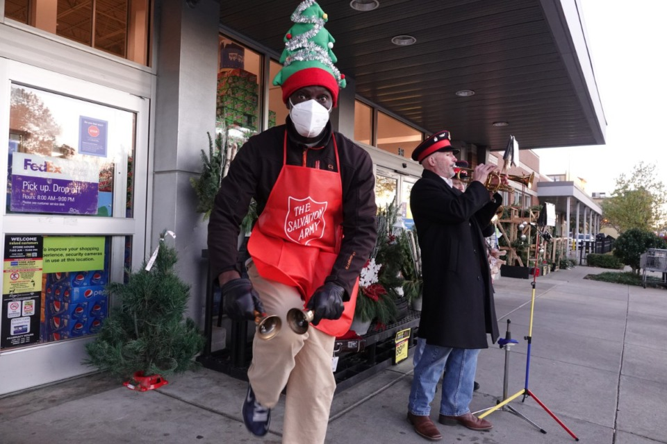 <strong>Salvation Army bell ringer, Larry Watt asks for donations outside the Kroger off Mendenhall in East Memphis. He&rsquo;s&nbsp; accompanied by Bill Bullock and Kent Stratton as they play Christmas songs on their cornets.</strong> (Karen Pulfer Focht/Special To The Daily Memphian)