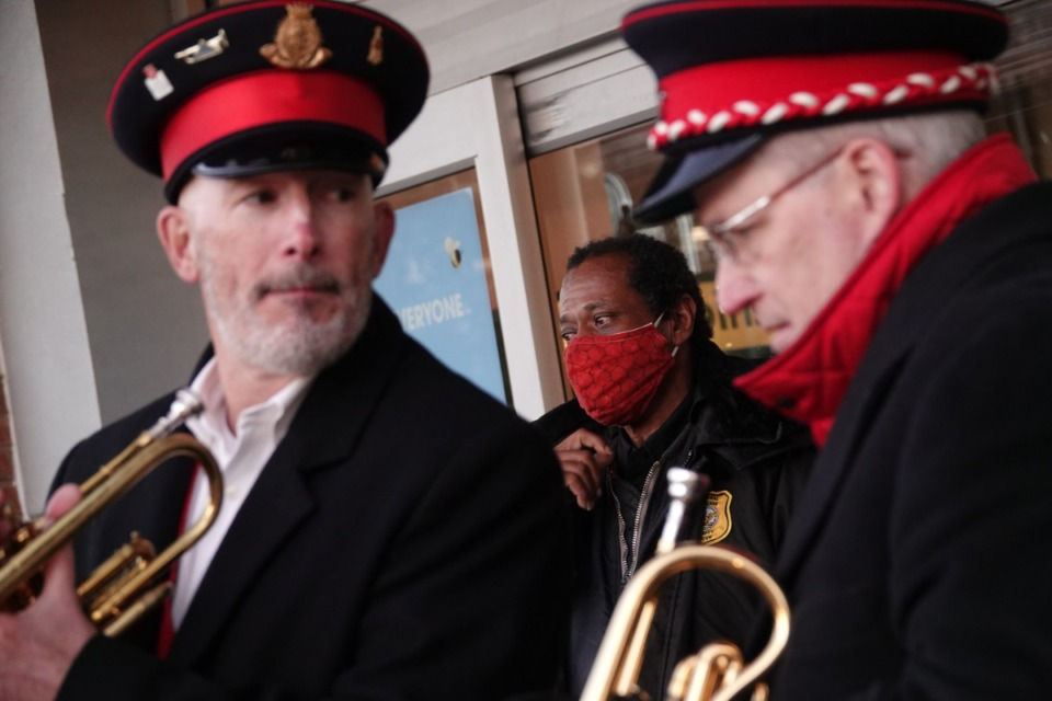 <strong>Bill Bullock and Kent Stratton play Christmas songs on the cornet outside the Kroger in East Memphis to help attract donors in what has been a down year for the Salvation Army.</strong> (Karen Pulfer Focht/Special to The Daily Memphian)