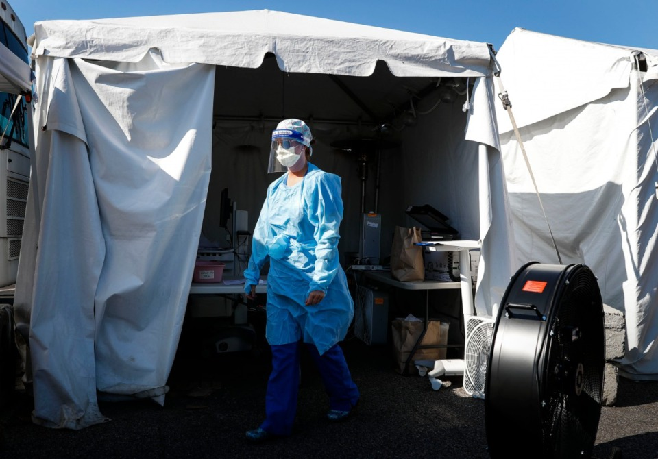 <strong>Medical workers administer COVID-19 swaps during a drive-thru testing site in June at Baptist Memorial Hospital-Memphis. Four Mid-South Baptist hospitals will begin getting the Pfizer vaccine this week, the system announced Monday, Dec. 14.</strong>&nbsp;(Mark Weber/Daily Memphian file)