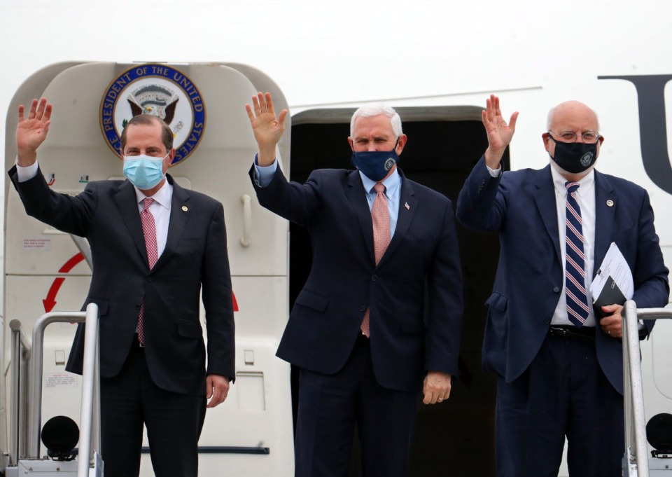 <strong>United States Secretary of Health and Human Services Alex Azar, Vice President Mike Pence and CDC Director Robert R. Redfield wave while exiting Air Force 2 during a trip to Memphis to give an update on Operation Warp Speed on Dec. 3, 2020.</strong> (Patrick Lantrip/Daily Memphian)