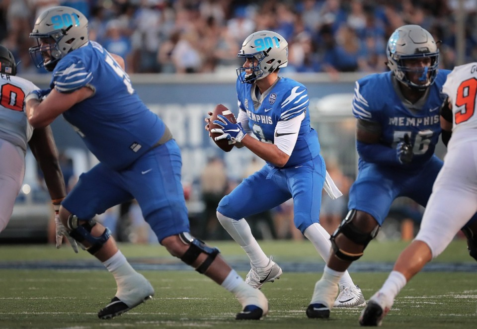 <strong>Though five University of Memphis football players made AAC all-conference teams Tuesday, record-breaking quarterback Brady White (center) went unmentioned.</strong> (Jim Weber/Daily Memphian file)