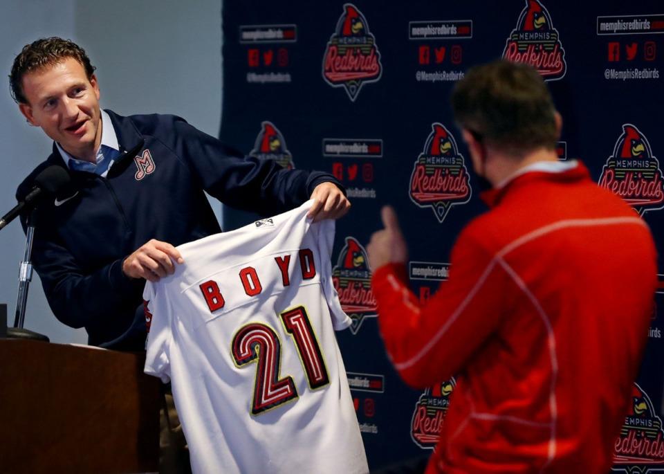 <strong>Craig Unger hands new Memphis Redbirds investor Randy Boyd a new jersey at a Tuesday, Dec. 15, press conference.</strong> (Patrick Lantrip/Daily Memphian)